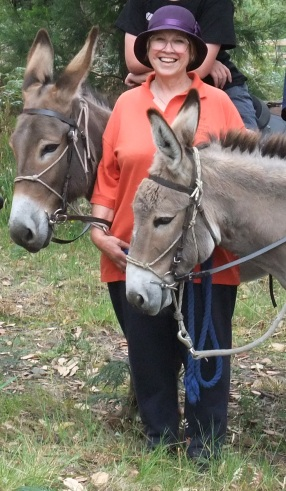 Gayelene Harrower with two of her beloved donkeys.