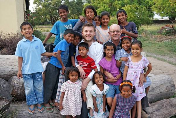 Clifton (left) and Rick Shipway with some of the happy kids at the Good Shepherd Agricultural Mission in India.