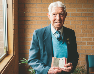 Lance Corporal Davies' Bible, now in his son Richard's care, is treasured in the family. Source: Bible Society Australia.
