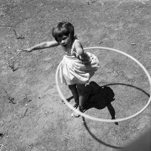 Girl_twirling_Hula_Hoop,_1958
